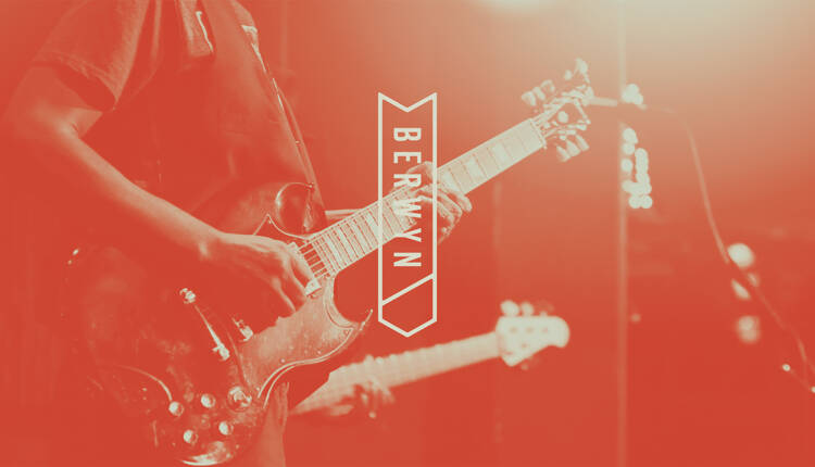 Berwyn logo overlaid on image of two people playing guitars on stage