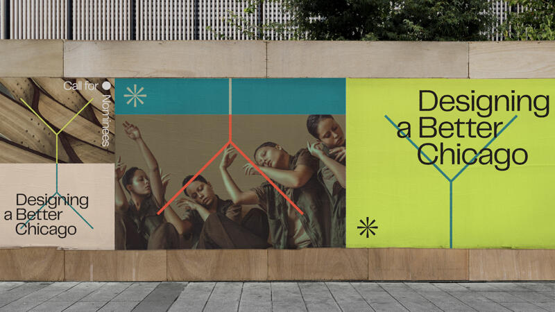 A series of oversized posters pasted onto on an urban wall