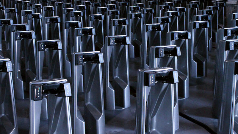 Rows of Divvy docks in a warehouse