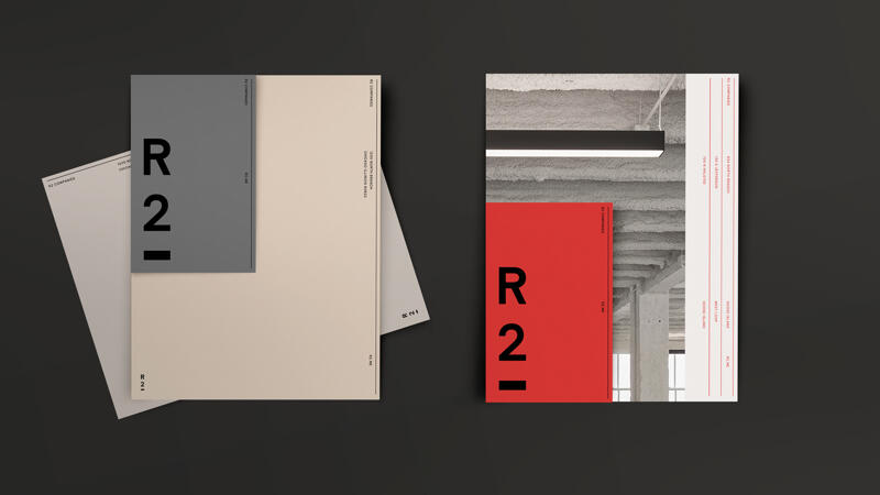 R2 letterhead and sell sheets in beige, gray, red and white