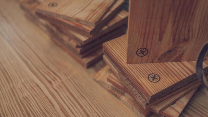 Rebuilding Exchange Wood Burned Logo