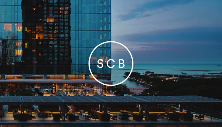 SCB logo overlaid on image image of Chicago highrise and Lake Michigan