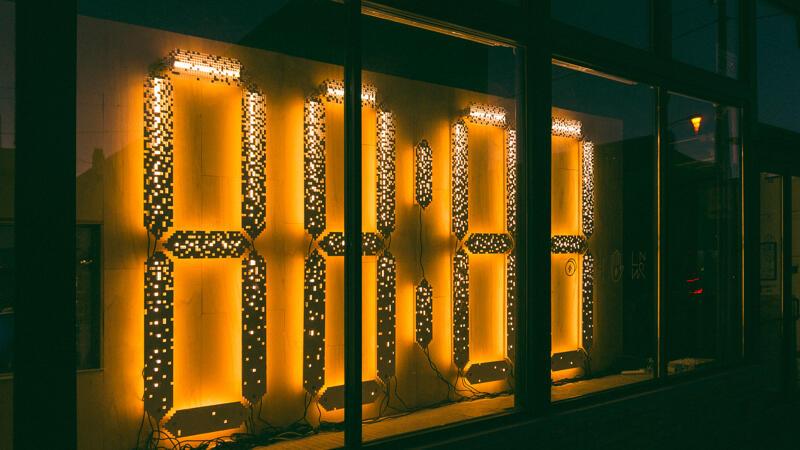 88:88 light installation seen from sidewalk