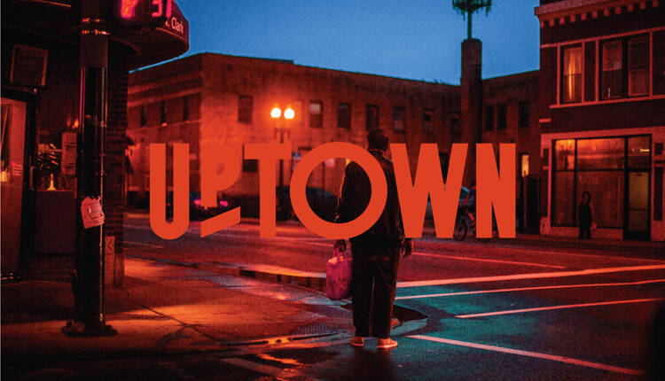 Uptown Logo overlaid on a dramatic evening neighborhood street scene