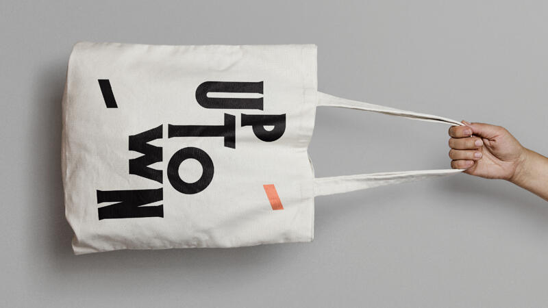 Canvas tote bag with Uptown logo printed on the front